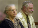 (Golden, Colo., December 14, 2004) Norma and Marvin Bredemeier sit in Jefferson County Court on...