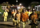 la conchita 1/10/04: Firefighters and rescue workers pull back from their rescue efforts at 8:54pm...