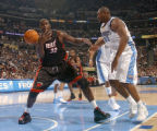 Denver, Colo., photo taken December 4, 2004- Miami Heat center, Shaquille O'Neal (left) looses...