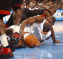 Denver, Colo., photo taken December 4, 2004- Nuggets forward, Nene, recovers the basketball in the...