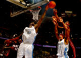 Denver, Colo., photo taken December 4, 2004- Nuggets forward, Francisco Elson (left) blocks Miami...