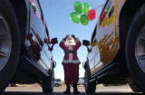 (LAKEWOOD, Colo., December 19, 2004) Hummer owner, Rich Johnson, dressed as Santa Claus takes a...
