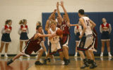 Chatfield's Ryan Beigie (00, red, left) reaches for a steal from Chaparral's Tyson Hamacher in the...