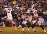 (San Diego, CA, December 5, 2004)  Sam Brandon runs into tkicker Mike Scifres late in the  in the...