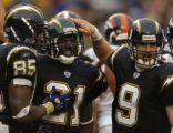 (San Diego, CA, December 5, 2004)  Drew Brees, right, congratulates LaDainian Tomlinson after his...