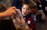 DENVER, COLO. - shot on November 30, 2004 -- Adam Carpenter-Dolce, age 8, enjoys listening to a...