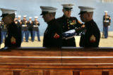 (12/20/2004)Denver-A member of a Marine Honor Guard from Buckley Air Force prepares to give the...