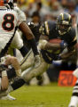 (San Diego, CA, December 5, 2004) LaDainian Tomlinson is tackled by the Broncos defense in the...