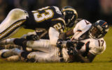 (San Diego, CA, December 5, 2004)  Darius Watts is tackled by Quentin Jammer and Donnie Edwards on...
