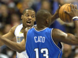 Denver, Colo., photo taken December 6,2004- Nuggets center, Marcus Camby, runs to stop Orlando's...
