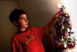 (Castle Rock, CO., SHOT 12/18/04)  Philip, 9, in his bed room at his home in Castle Pines on his...