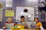 (12/07/2004)Littleton, Colorado-East Elementary students Charles Erle, from left, Don Park and...