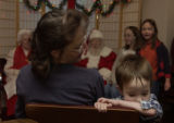 (ENGLEWOOD, Colo., December 4, 2004) Carol Brunkala looks over at her son Anthony,3, who didn't...