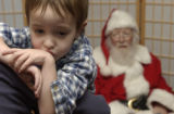 (ENGLEWOOD, Colo., December 4, 2004) Anthony Brunkala,3, on his mom Carol's shoulder, was brave...