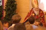 (LITTLETON, Colo., December 4, 2004) St. Nick listens carefully to group questions after telling...