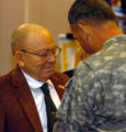 (Colorado Springs, Colo., December 7, 2004) Ft. Carson  Commander Maj. Gen. Robert Wilson pins a...