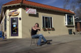 (DENVER, Colo., January 26, 2005)  Sarah Bohan sits outside the Perk & Pub, 797 S. Emerson...