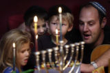 (Denver, Colo.,12/7/2004) (L-R) Sydney Becket 4,  Ryan Beckett,8 , Barry Dechtman2, and Evan...