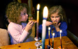 (Denver, Colo.,12/7/2004) (L-R) Estee Dechtman 4,  and  Sydney Beckett, 4 (blue)  enjoy their...