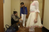 (DENVER, Colo., December 8, 2004) Margarita Ramirez works on matching the soldier costume leg...