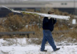 (MONTROSE Colo., December 1, 2004) Federal investigators pick up pieces of the jet, that crashed...
