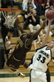 (Littleton, Colo., December, 2004)  Pierre Allen, of Jefferson, goes up for the ball after missing...