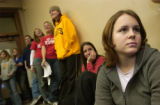 (Boulder, Colo., November 17, 2004) Lauren travis, 19, right, listens as Robert Coombs speaks to...