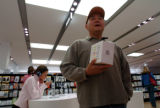 (DENVER, CO., DECEMBER 24, 2004)  Paul Wang, of Aurora, ponders the purchase of a Mini IPOD for...