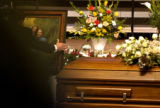 (12/10/2004) Littleton, Colorado-A funeral director places a family photo of Chriss Sewell and his...