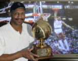 OHRS204 - SPECIAL TO THE DENVER ROCKY MOUNTAIN NEWS--Former NBA player Larry Nance poses wit his...