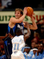 Denver, Colo., photo taken December 26,2004- Dallas center, Dirk Nowitzki (top) is guarded by...