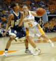 TNWP103 - Tennessee's Shanna Zolman (5) drives against George Washington's Kimberly Beck (5)...