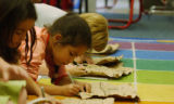 (DENVER, Colo., Nov. 9, 2004) First grader Perri Earnest, 6,  (center) of Edison Elementary...