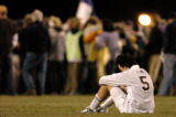 (ARVADA., NOVEMBER 9, 2004)  Faith Christian's #5, J.D. Lind sits on the field as Salida fans...