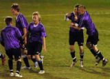 (ARVADA., NOVEMBER 9, 2004) Salida's #3, Chance Bergman, right, hugs #10, Aaroin Hanes, center, as...