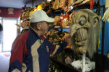 (DENVER Colo., November 24, 2004) Ron Gebhardt, of Aurora, checks out a mask in the costume...