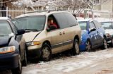 (DENVER, Colo., January 12, 2004) Vicky Zokovsky, sits in her mini van, frustrated as she wait for...