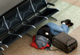 (Denver, Colo., November 24, 2004) Evan Siegfried, 21, of St. Louis, sleeps on the floor while...