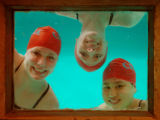 (11/24/04, Denver, CO) 2004 Girls Swimming Preview: (l-r) Natasha Menezes, Caitlin Iversen and...
