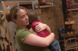 (Craig, Colo., November 9, 2004) Brandy Hixson, left, hugs her son Gregory Hixson, at the home of...