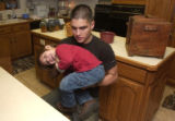 (Craig, Colo., November 9, 2004) Cory Hixson, 21, who was wounded in Iraq, plays with his nephew...