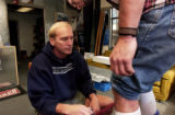(Boulder, Colo., november 11, 2004) Larry Houchen, of Larry's Boot Fitting, does a fitting for...