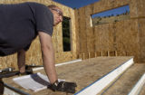 (Boulder, Colo., November 5, 2004 ) HGTV DREAM HOUSE PROJECT.  Christopher Herr helps with the...