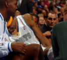 (DENVER, CO., NOVEMBER 11, 2004)  Denver Nuggets #23, Marcus Camby grimmaces in pain on the team...
