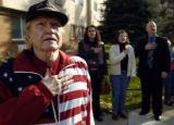 (DENVER, CO. NOVEMBER 11, 2004) Korean War Navy veteran Reno Cooke, left, says the Pledge of...