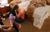(Vernal, Utah) Jonathan and Amber embrace on the floor of the bedroom of their home in vernal,...