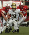 (Lincoln NB, November 26, 2004)  Joel Klatt, of CU runs with the ball while being pursued by the...