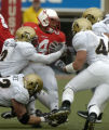 (Lincoln NB, November 26, 2004)  The Colorado defense converges onCory Ross in the first quarter...