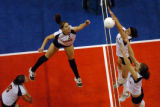 (DENVER, CO., NOVEMBER 12, 2004) Sterling's #3, Audrey Starkelbaum punches the ball over Fort...
