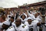 (Lincoln NB, November 26, 2004)  Members of the CU football team celebrate their victory against...